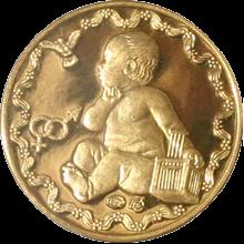 Zlatá medaile k narození dítěte